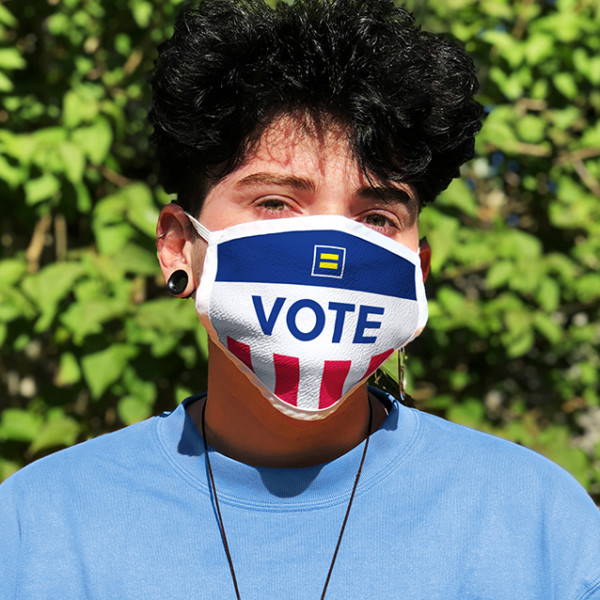 Person wears a red, white and blue mask with a Human Rights Campaign logo that says VOTE underneath it.