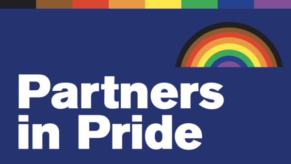 "Illustration of a rainbow. Text reads ""Partners in Pride"""