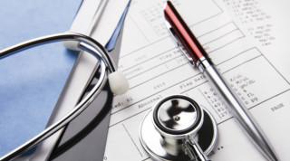Stethoscope sitting on medical records
